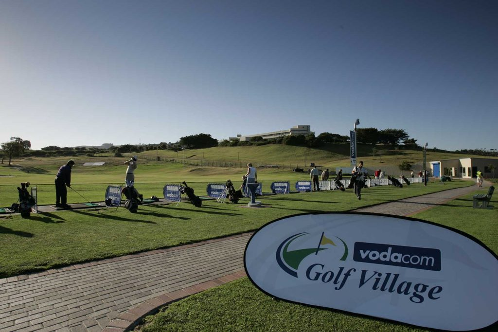 people playing golf at driving range, The Golf Village